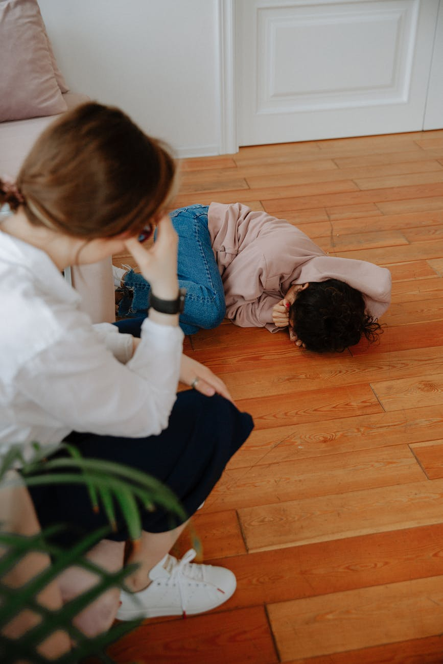 young woman crying on floor