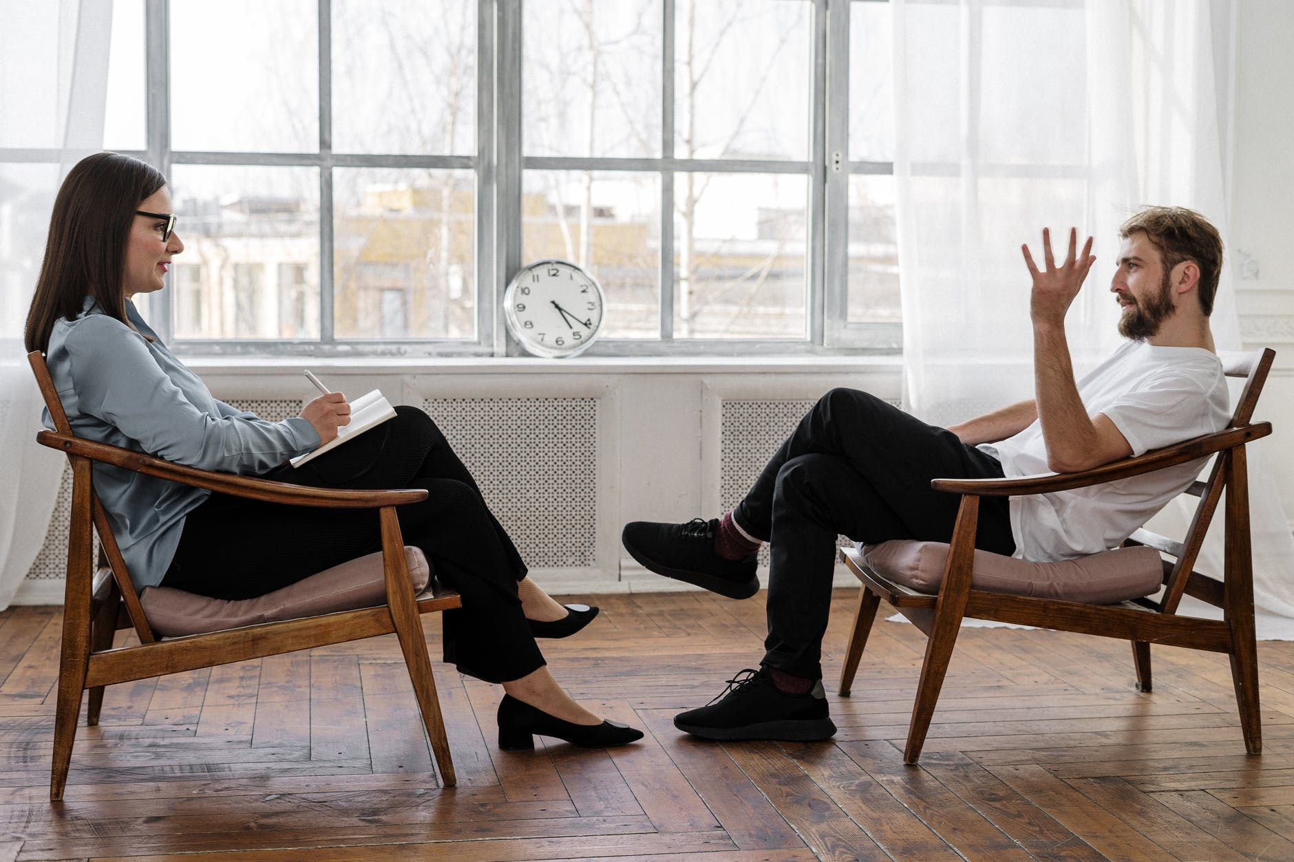 A psychologist and patient in a relaxed session
