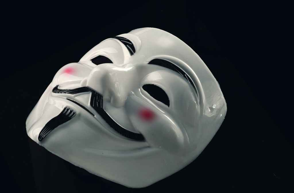 Mask with a stylised depiction of Guy Fawkes